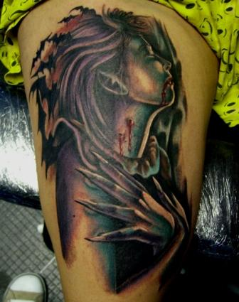 Scary Bleeding Vampire Tattoo On Thigh
