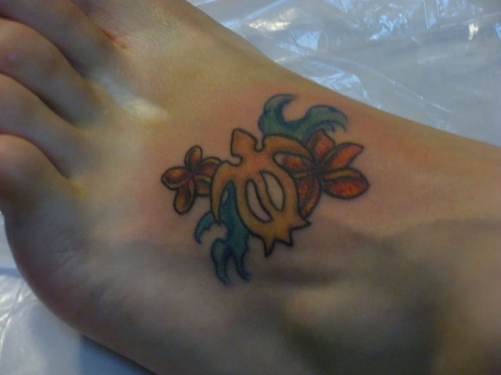 Tribal-Tattoos sea-turtle-tribal-tattoo-with-flowers-on-foot