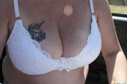 Sexy Unicorn And Flowers Tattoos On Breast