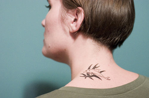 Small Tribal Dolphin Tattoo On Neck Back