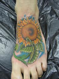 Sunflower With Green Leaves Tattoos For Foot