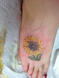 Sunflower With Green Leaves Tattoos On Foot