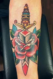 Traditional Dagger Rose Tattoo On Arm