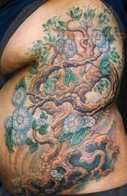 Tree Flowers Tattoos On Rib Side