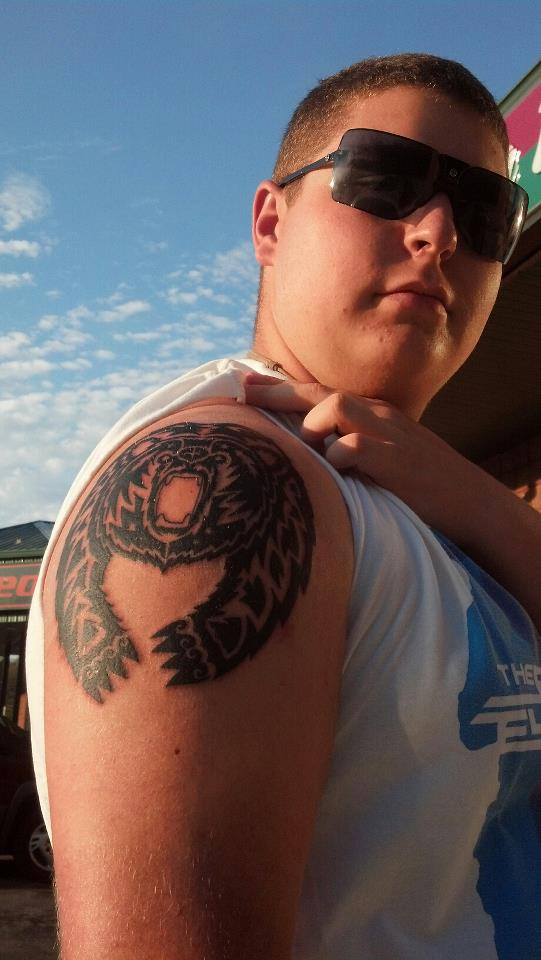 Tribal Bear Tattoo On Boy's Shoulder