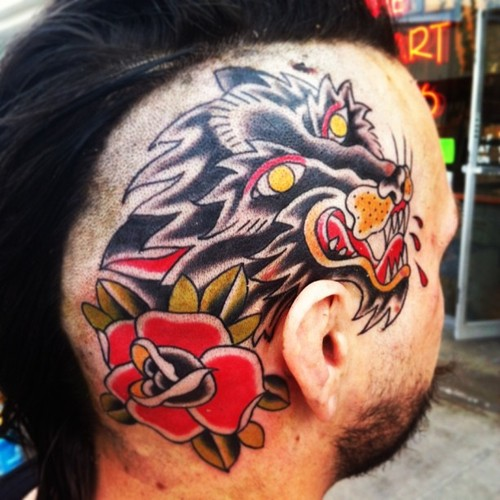 Wolf And Traditional Flower Tattoos On Head