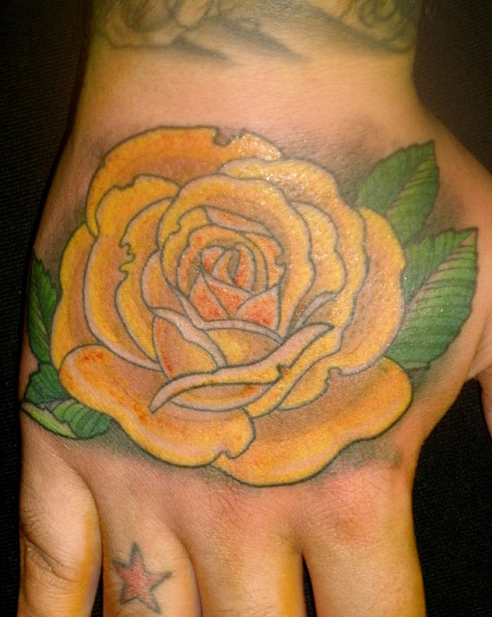 Yellow Rose Traditional Tattoo On Hand