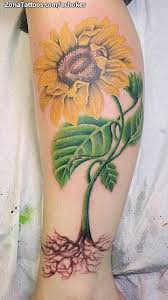 Yellow Sunflower With Green Leaves Tattoos For Leg