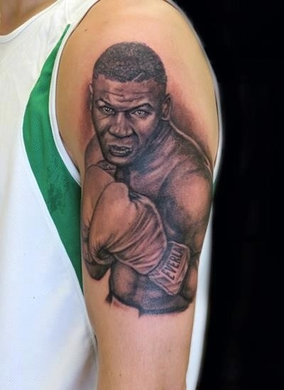 Mike Tyson Portrait Tattoo On Muscles