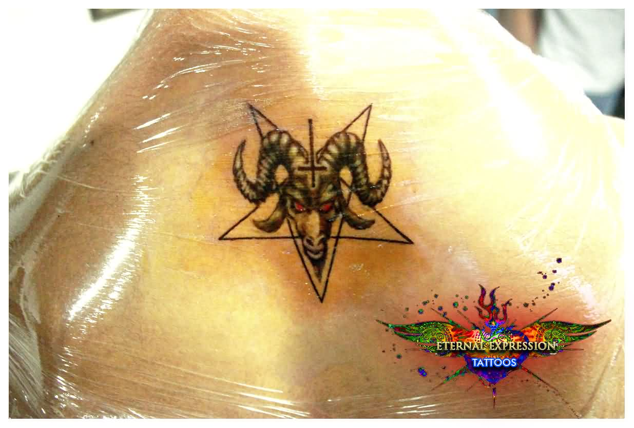 Pentagram Star And Aries Head Tattoos