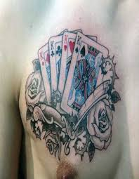 Playing Cards And Roses Tattoos On Chest