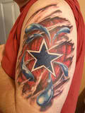 Ripped Skin Dallas Cowboy Tattoo On Biceps