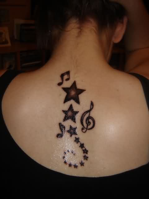 Sparkling Stars And Music Note Tattoos On Upperback