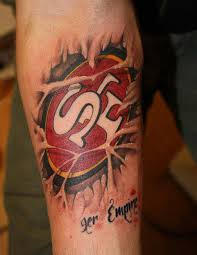Sports Ripped Skin Tattoo On Forearm