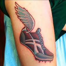Sports Shoe With A Wing Tattoo