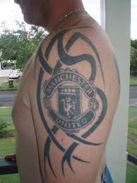 Tribal And Manchester United Tattoo On Biceps