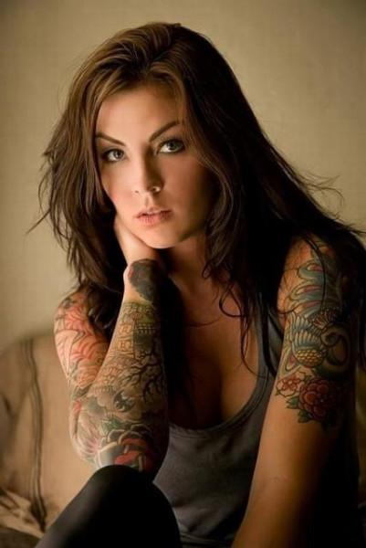 A Beautiful Girl With Sleeve Tattoos