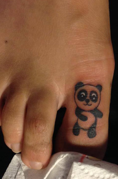 A Cute Panda Tattoo On Toe
