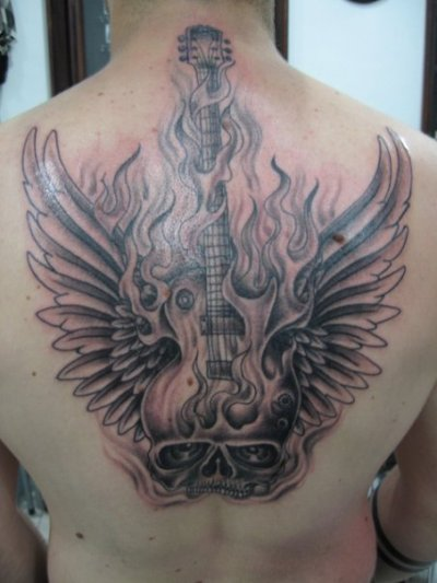 A Flaming Skull Guitar Tattoo With Wings Is A Great Design For People Who Enjoy Rock Guitar Music