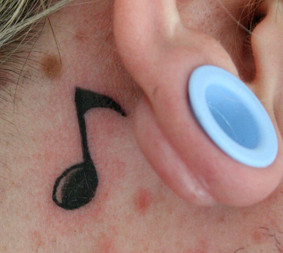 A Very Cute Music Note Tattoo Behind Ear