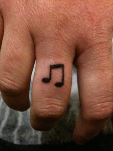A Very Cute Music Note Tattoo On Finger