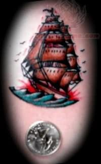 Amazing Colored Pirate Ship And A Silver Coin Tattoo