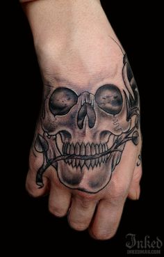 Amazing Grey Ink Skull Tattoo On Hand