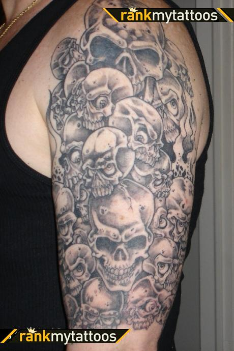 Amazing Grey Ink Skull Tattoos On Half Sleeve