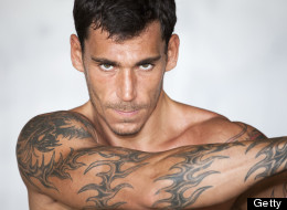 Amazing Grey Ink Tribal Tattoo On Muscles