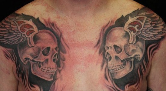 Amazing Grey Ink Winged Skull Tattoos On Chest