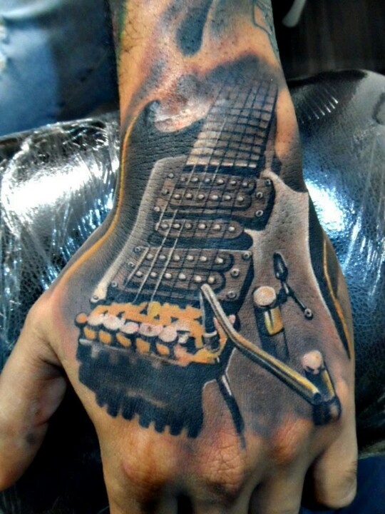 Amazing Guitar Realistic Tattoo On Hand