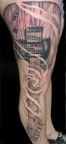 Amazing Long Guitar Tattoo On Leg