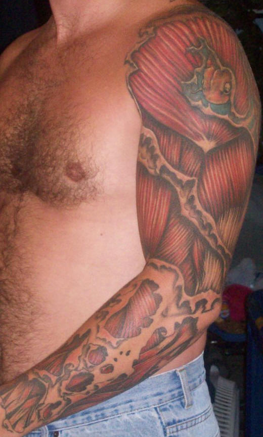 Amazing Muscles Ripped Skin Tattoos On Sleeve