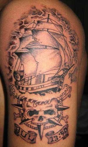 Amazing Ship And Skull Wheel Tattoos On Arm