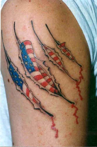 American Flag Ripped Skin Tattoo On Biceps