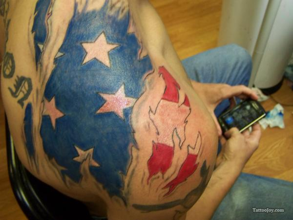 American Flag Ripped Skin Tattoo On Shoulder