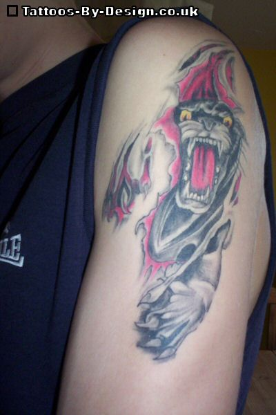 Angry Panther Ripped Skin Tattoo On Biceps