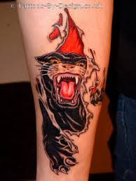 Angry Panther Ripping Through Skin Tattoo