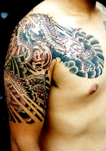Asian Shoulder And Chest Tattoos