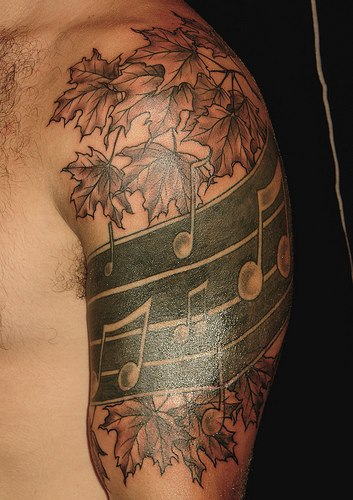 Autumn Leaves And Music Tattoos On Half Sleeve