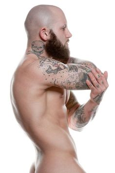 Bald Man With Muscles Tattoos