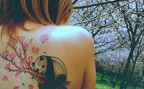 Beautiful Panda On Blossom Branch Tattoo