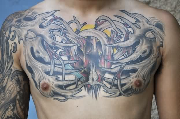 Biomechanical Skeleton With Heart Chestpiece Tattoos