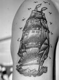 Birds Around Ship Tattoo On Upper Arm