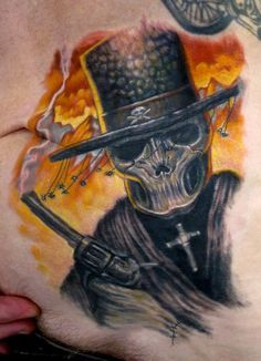 Black Skull With Gun Tattoo On Waist