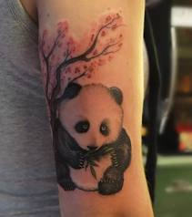 Blossom Tree And Panda Eating Leaves Tattoo On Arm