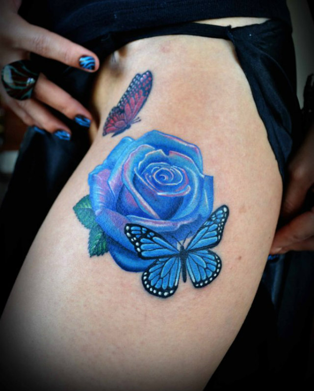 Blue Rose And Butterfly Thigh Tattoos