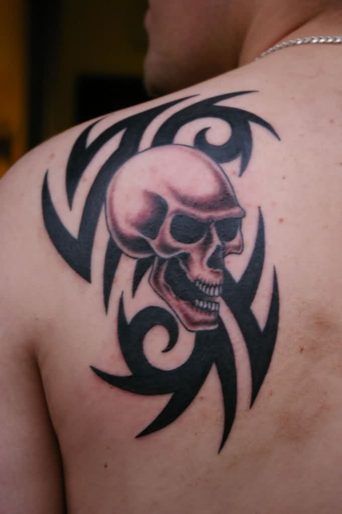 Bold Tribal And Skull Tattoo On Back Shoulder