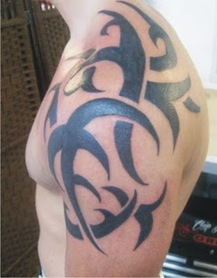 Bold Tribal Tattoo On Shoulder For Men