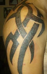 Bold Tribal Tattoo On Shoulder